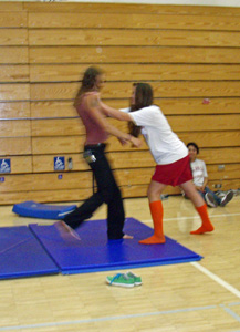 Sherman demonstrates the safe fall with the aid of a student