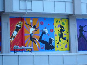 Students create new sports themed mural at santa cruz high for Elementary school mural ideas