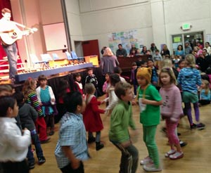 El Sistema builds community and skills through movement as well as music instruction.