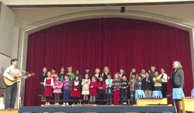El Sistema Santa Cruz sing along led by teachers Zach Ragent and Kris Kennedy