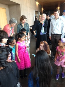 El Sistema students are greeted by an opera performer.