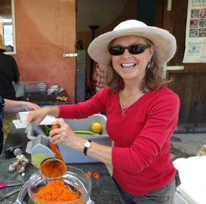Susan Dahlgren making salad from the garden